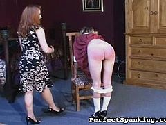 Mistress Gemini is a redheaded woman who takes pleasure out of spanking little girl's asses. This blonde schoolgirl gets spanked until her butt turns all red.