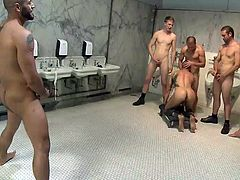 What's happening in this public bathroom? Between those dirty urinals and sinks we have a bunch of horny men and a very obedient sex slave. Muscled Marcus is the boy toy and he enjoys to be humiliated, dominated ass fucked by all these men. They rub his cock, finger his anus and then, mouth and ass fuck him.
