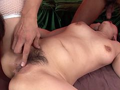 Perverted and lewd asian slut Megumi Haruka in sexy white fishnet stockings gets her unshaved snatch fingerfucked by two guys.