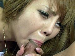 one guy spreads her pussy wide and another sticks his first to fingers up in there. She moans at first, but pretty soon she likes it. She licks one of the guy's nipples while the other sticks his cock in that vagina. He pulls out and rubs her cunt some more and this Japanese whore sucks the other guy's dick.
