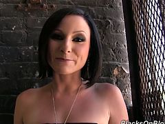 Slutty brunette milf Veruca James smokes a cigarette and gives an interview. Some black stud approaches her from behind, grabs her tits and plays with them.