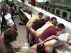 At this washing center things get fucking dirty. A pretty gay guy is putted to suck cock and lick ass like a cheap whore. Then the guys humiliate him some more and make him enter a washing machine. Does he feels dirty? Well a few hard cocks in his mouth will surely wash the taste of ass