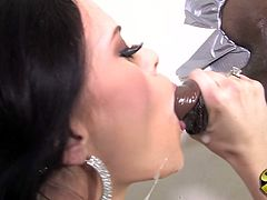 Engaging brunette Angelina Black is playing with a fat black dick sticking out of a gloryhole. She sucks and rubs it ardently and then gets her snatch fucked deep from behind.