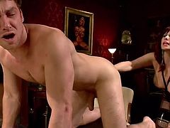 Redhead goddess Madeline is a cruel and dominating mistress. she makes her slave get down on all fours on top of the table and she grabs his cock hard from behind. He gets his tight asshole fingered fast while she strokes his cock.