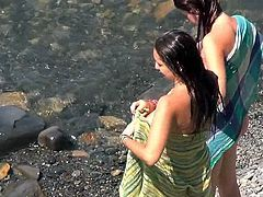 Enjoy voyeur's hidden cam filming nude hottie at the beach