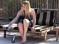 Click to watch this chubby blonde, with huge nipples wearing glasses and high heels, while she touches herself in an amateur clip.