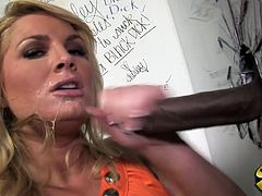 Touch yourself watching this blonde MILF, with big breasts and a nice ass, while she has interracial sex with a black man in a gloryhole.