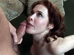 A lustful MILF with big boobs gives a blowjob to a younger guy. Then she takes off her dress and gets fucked in her bushy pussy.