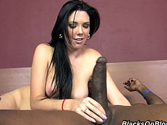 Well-endoewd brunette Megan Foxx kneels in front of a black man and lets him face-fuck her. Then they bang in reverse cowgirl position and have terrific anal sex.
