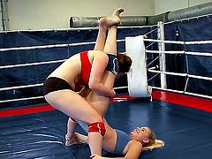 Attractive young blonde babe Brandy Smile with pretty face and juicy ass and asian brunette Tigerr Benson with huge tits in booty shorts are fighting in the ring just for fun.