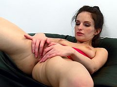 A brunette chick in jeans shorts licks her nipples and then strips off clothes. Ann lies down on an armchair and fingers her pink pussy.