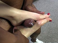 Larkin Love is a curvaceous office chick in glasses. She takes off her shoes and oils her feet up. Larking gives a skillful footjob to a Black dude with big penis.