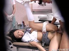 She went in for a cleaning and got a reaming. After working on her teeth, this Asian babe got double teamed by her two dentists.