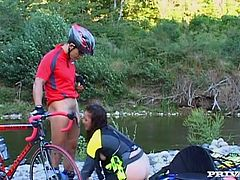 Check this brunette MILF, with a nice ass wearing sportive clothes, while she goes hardcore with a horny man next to a lake and moans like a wild animal.