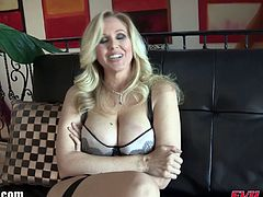 Julia Ann's ass gets stretched out with fingers and big anal plugs. She then gets her ass pounded with a strap on while making herself cum with a vibrator.