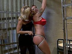 Attractive experienced blonde milfs Kathia Nobili and Pamela with juicy asses and pretty faces in sexy red underwear and high heels enjoy having kinky bondage fantasy in prison cell