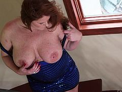 This well-aged skank pulls her massive melons out of her cocktail dress and shows them off for all to see. She can't forget about her pussy so she plays with that for a little bit. Her jugs are so gigantic she can suck her own nipples. She's only one of the horny cougars you'll see right here.