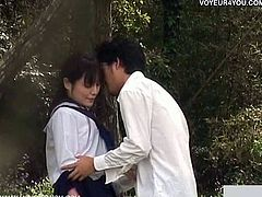 Here's one naughty Japanese teen brunette babe giving her man a hell of a blowjob in the park. She definitely looks hot in her schoolgirl uniform.