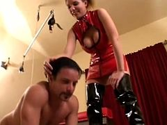 Press play to watch this blonde lady, with big knockers wearing latex clothes, while she mistreats two babes and a dirty guy for her own pleasure.