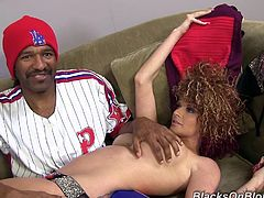 A White girl with big boobs lies on a sofa. A Black guy touches and fondles Joslyn's big boobs and booty in a behind the scenes video.
