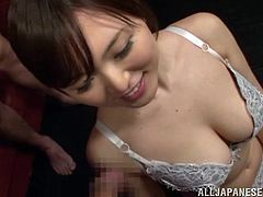 A hot Japanese girl in a lingerie sits on the floor in front of at least seven guys. Each guy comes up to Yua and cums on her face. It is the most memorable bukkake experience in her life.