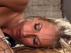 Hot blonde bitch in fishnets fucked well in a steamy hardcore scene.