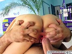 Check this brunette, with big knockers wearing a cute bra, while she goes hardcore with two guys at the same time and moans loudly.