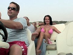 Take a look at this hardcore outdoors scene where the slutty brunette Tiffany Merlot is drilled by a thick cock on a running motor boat.