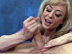 Watch the sexy mature blonde Nina Hartley giving this guy a massage before sucking and riding his thick cock in this hardcore scene.