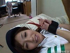 An Asian naughty young girl lies down on a bed, with her hands tied. She´s very permissive and spreads her legs, allowing to be fingered. When she becomes very horny, all that remains her to do, is to start making oral sex to her fuck-buddy. If you want to see her fluffy unshaved pussy, click to watch the video!