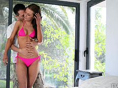 A tall slim chick in a pink bikini is invited to play inside the house by her companion. They help each other to undress and the rest comes really easy. The bitch unzips his pants and sucks the guy's dick, while he seems fascinated by her nipples and pussy. Watch here all the hot scenes!