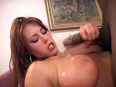 Have a blast watching this redhead cougar, with gigantic gazongas wearing high heels, while she has interracial sex with a black dude.