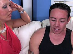 This momma is such a slut. She sees her son's hot friend and invites him over, for some kinky action. She pulls his cock out and gives it a good suck. Of course, she has to pull her tits out, so he can have a good look. Watch, as she sits on his face and sucks him off.