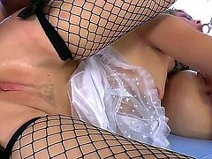 Kinky submissive sluts Dana DeArmond and Zoey Monroe with nice body figures and big beautiful eyes in fishnet stockings have provocative anal play while Will Powers films them in pov.