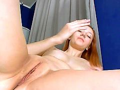 All natural, pale skinned Russian redhead Sashenka rocks her pussy on the glass table