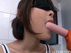 Petite Sayoko poses for a guy in the swimsuit. This babe gets oiled up and then blindfolded. She sucks the sausage and dildos. Of course Sayoko also blows a dick.