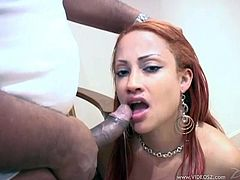 Mouth full of cum for a sizzling redhead bitch