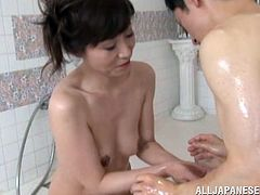 Slim Japanese milf Kana Tsuruta and her man are having fun in a bathroom. The slut shows her rimjob skills to the dude and then they bang in cowgirl position.