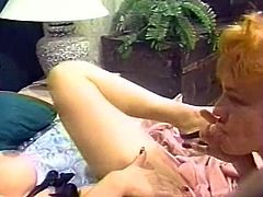 Bosomy brunette chick passionately eats moist hot blooded vagina of her red haired slutty helpmate. Look at these insatiable lesbians in The Classic Porn sex clip!