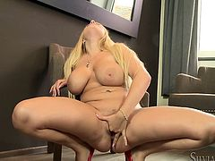 Get a load of Angel Wicky's big round tits and her perfectly shaved pussy in this solo scene where she plays with herself.