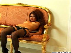 Be part of this clip where an Asian brunette, with big jugs wearing fishnet stockings, touches herself in a really erotic way sitting on a nice couch.