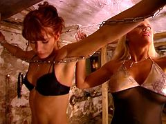Hot bdsm lesbian action as horny blonde German mistress dominates a sexy brunette babe by tying her up and whipping her sexy ass