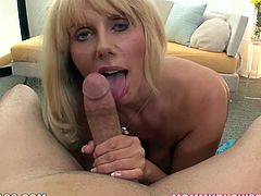 Voluptuous blonde mom exposes big boobs for camera. She then pulls out hard flesh out of dude's pants. She gives him super hot blowjob.