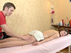 A beautiful girl gets massaged by a tricky masseur. He fondles girl's ass and toys the pussy with a Magic Wand. The girl gets so horny that give a blowjob to the masseur. This cutie gets fucked deep in her tight ass from behind.
