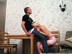 Shameless blonde babe takes hard dick in her mouth. She pumps meaty sausage while the guy is sitting on top of the dinner table. Later on she gets nailed missionary style.