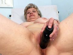 Mature Ruzena is with a stiff toy stuck deep in her hairy old twat