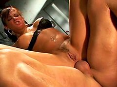 Slutty brunette chick with big boobs fucks her coach in a locker room. He pounds her snatch in a missionary position while the girl lies flat on a bench. Then, she bends over taking massive dong deep up her anus. Solid built coach destroys her fuck holes in hardcore session. He also feeds the student with big load.