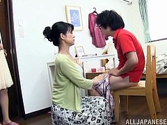 Make sure you have a look at this hot scene where this horny mature Asian sucks and jerks on her friend's son's hard cock.