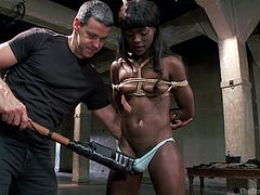 Black brunette Ana is as black as it gets and this ebony babe will found out how rough things can get with white boys. She's tied up and the white executor approaches her, makes himself clear and then raises her legs and hangs her. Ana has nothing to do now but accept her fate and endure what he has for her.