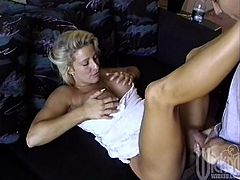 He lays this sexy MILF back and gives her every inch of his hard cock as he fucks her brains out then busts a nut all over her face.